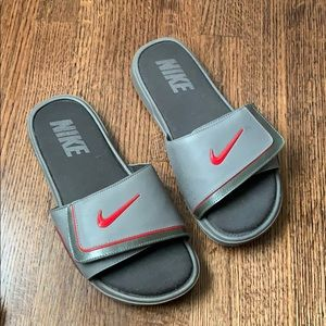 Gray and Red Nike Slides